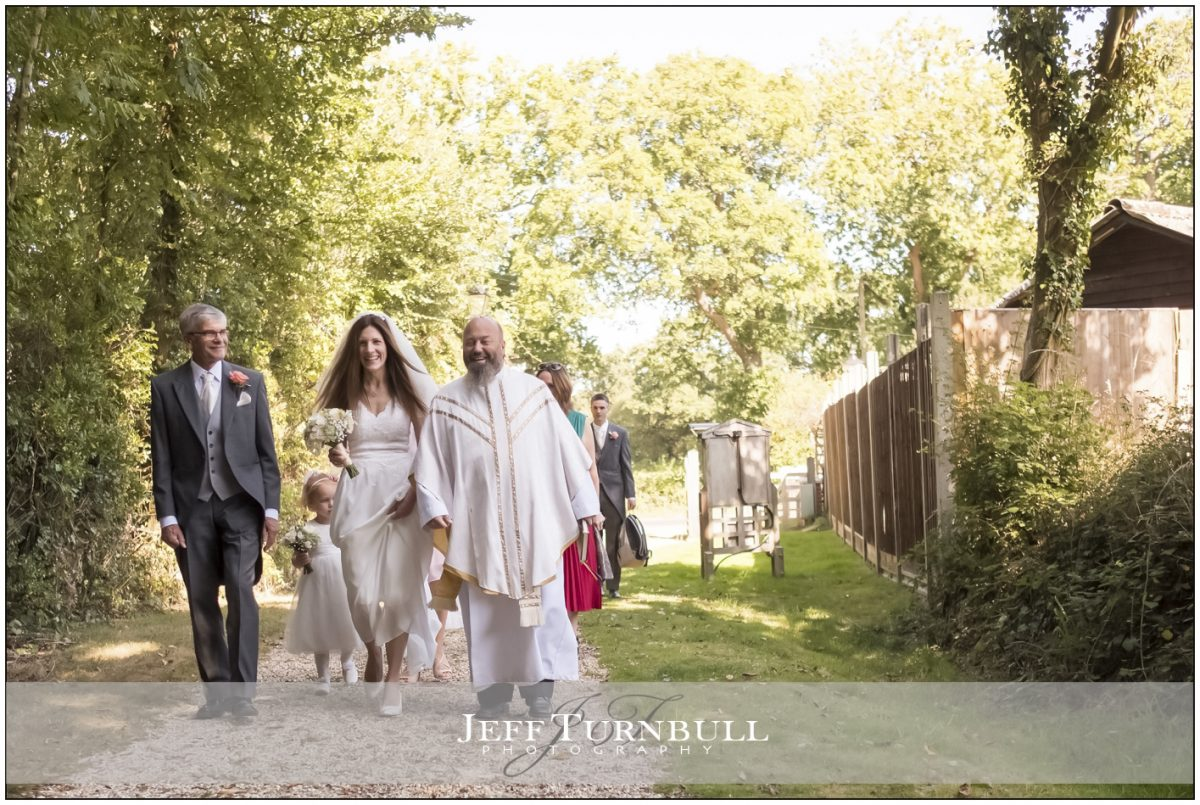 Bride and Dad walking up the lane