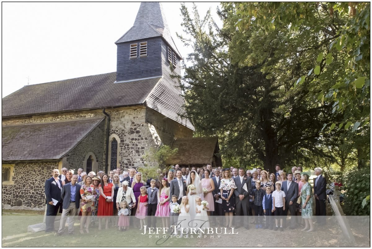 large group photograph outside the church