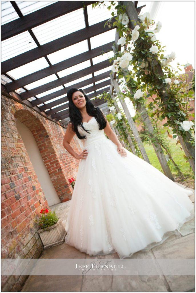 Bride walking under pergola