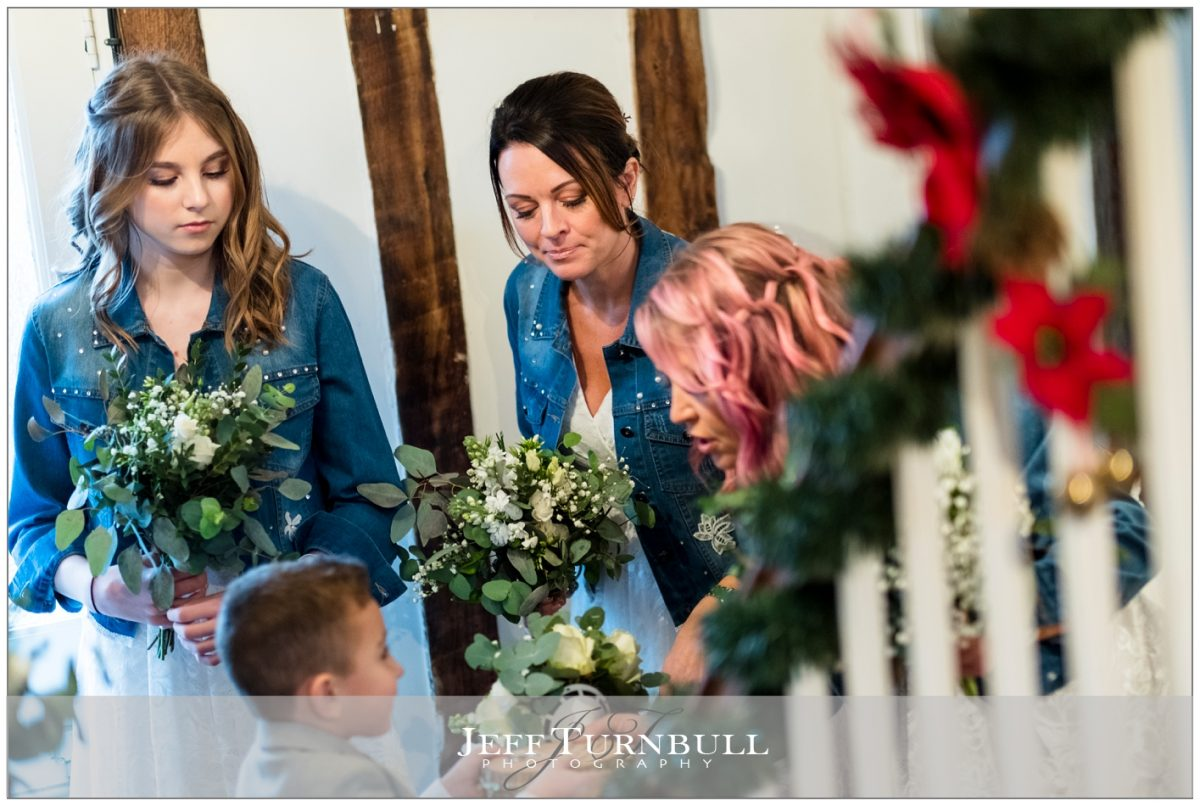 Bridesmaids talking with the pageboy