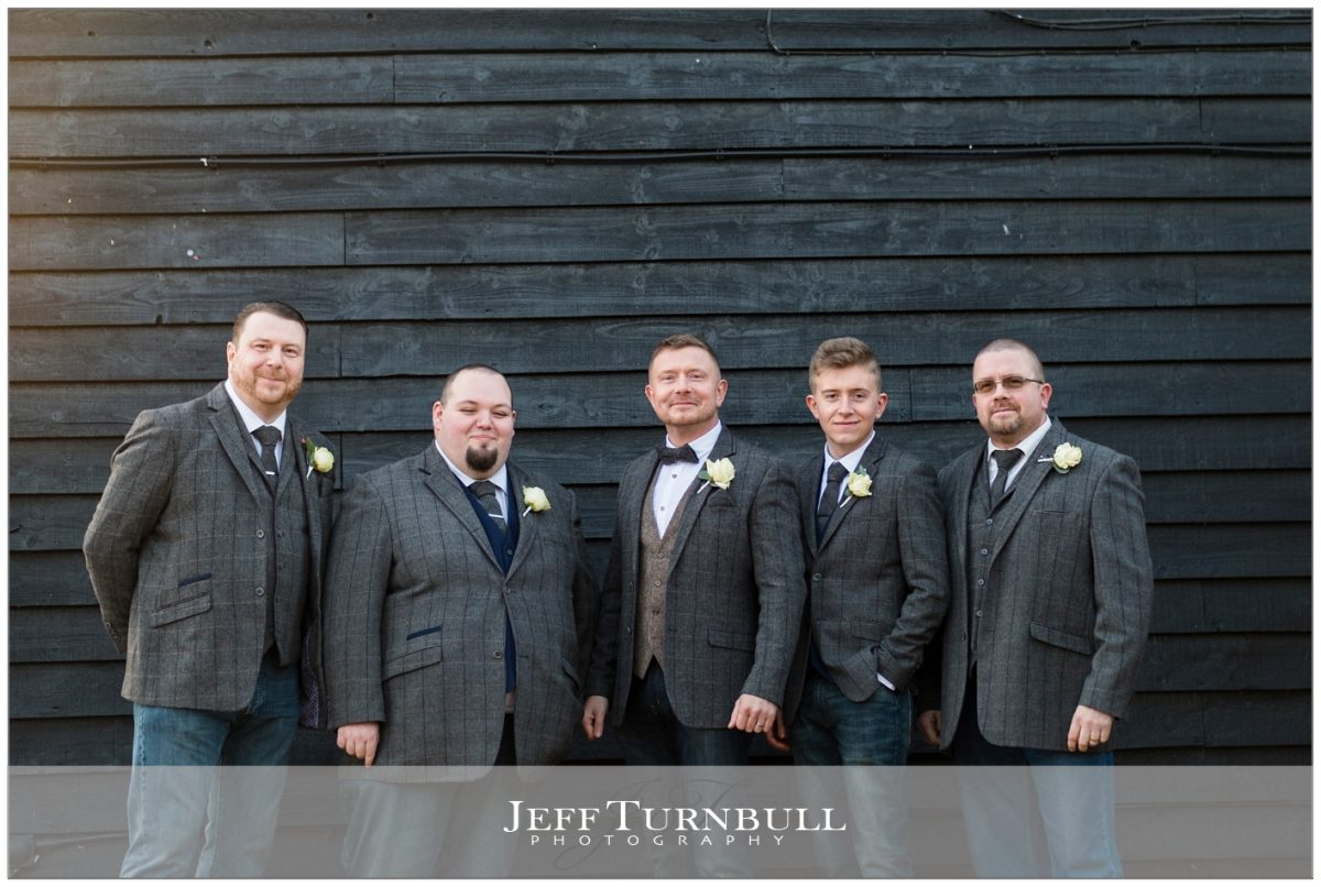 The groom and his groomsmen looking dapper