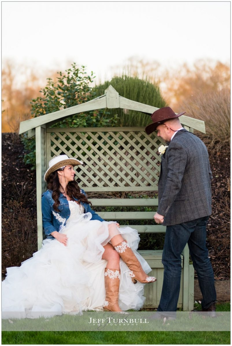 Bride and groom together wearing their country and western outfits