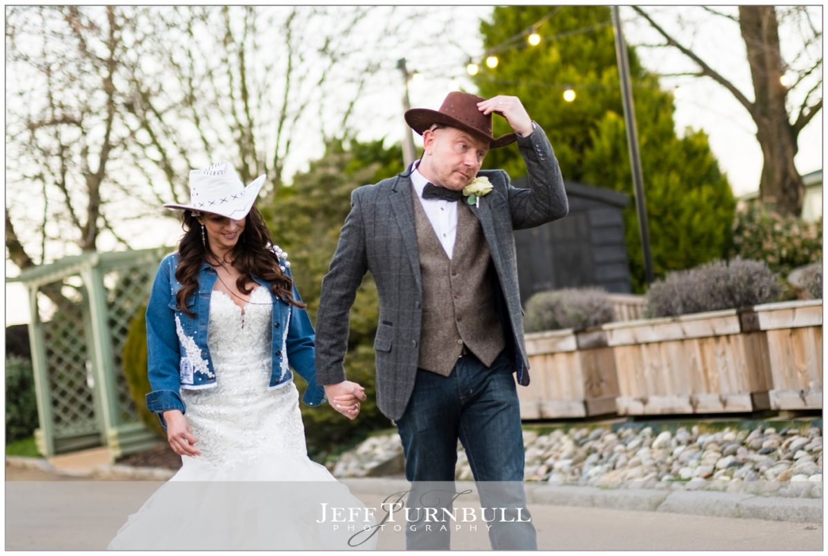 Bride and groom wearing stetson hats