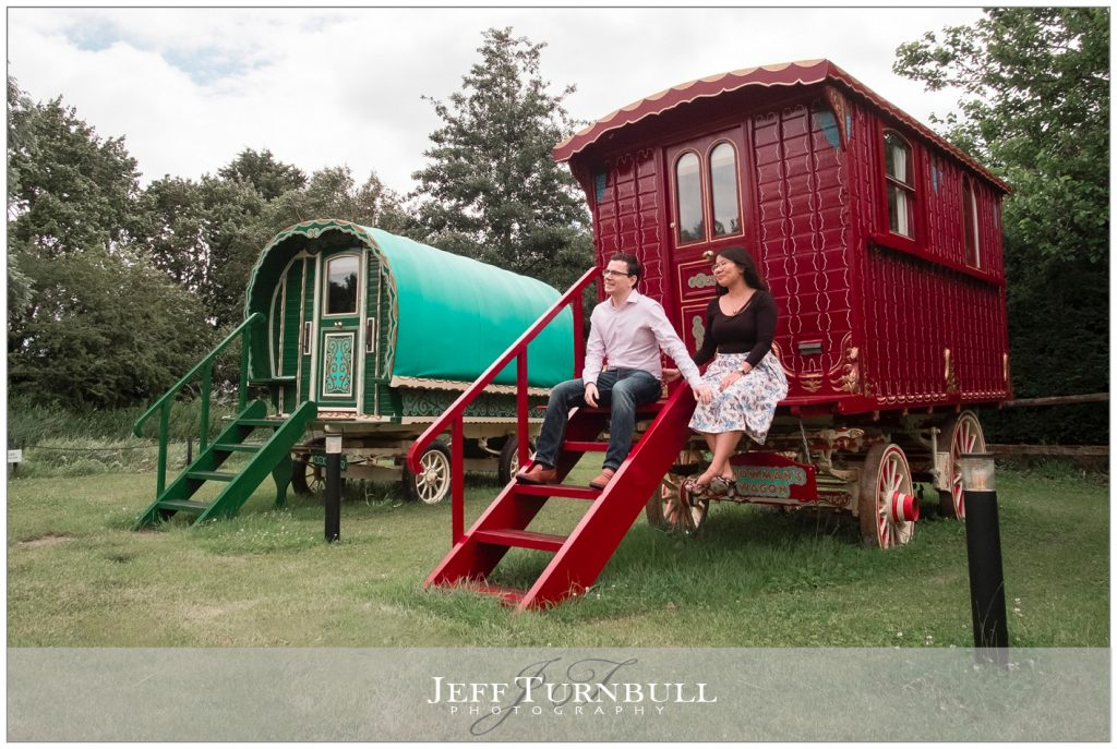 Engaged Couple sitting on the Gypsy Caravan