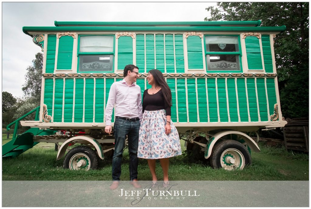 Engaged Couple in front of a Gypsy Caravan