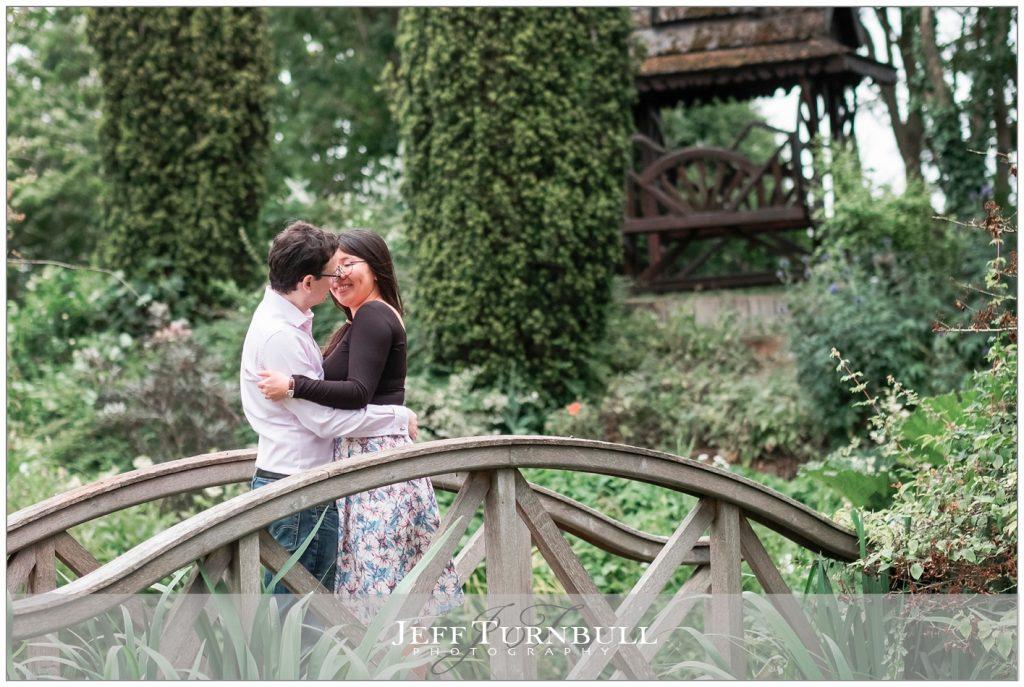 Engaged couple Kissing on the bridge