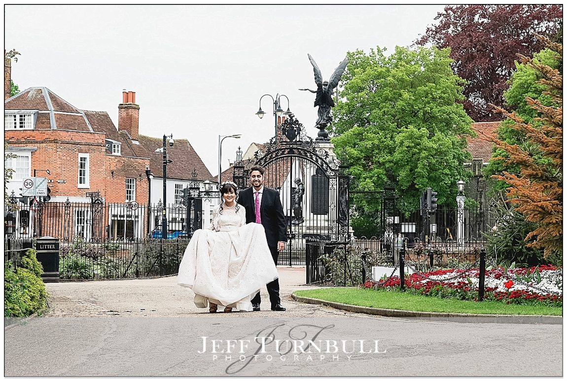 Bride and Groom Walking in Colchester Castle Park