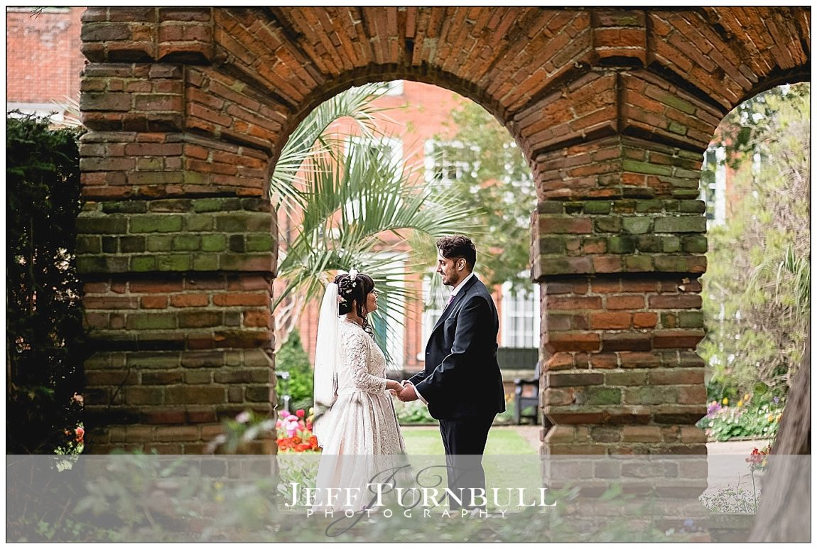 Bride and Groom Under an Arch