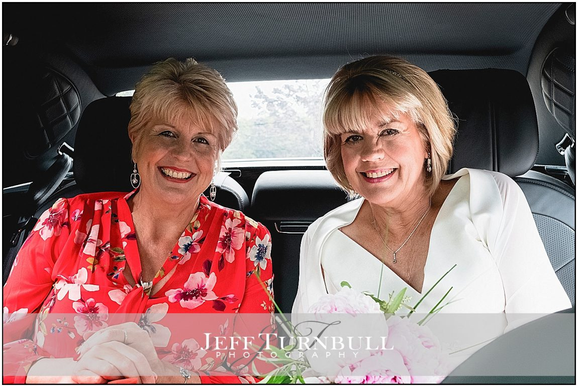 Bride and Maid of Honour in Wedding Car