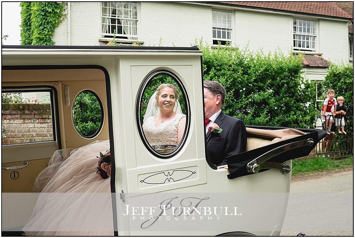 Bride in the Vintage Wedding Car