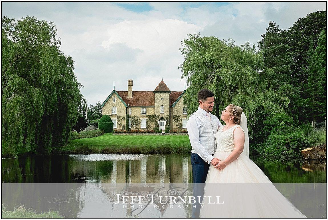 Bride and Groom The Lake Smeetham Hall Barn