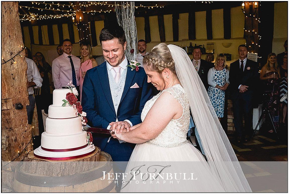 Bride and Groom Cutting Cake Smeetham Hall wedding