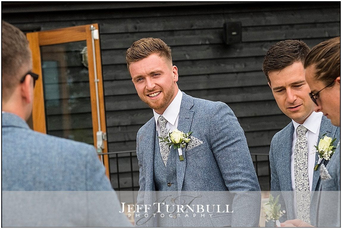 Groom outside the Barn at Villiers
