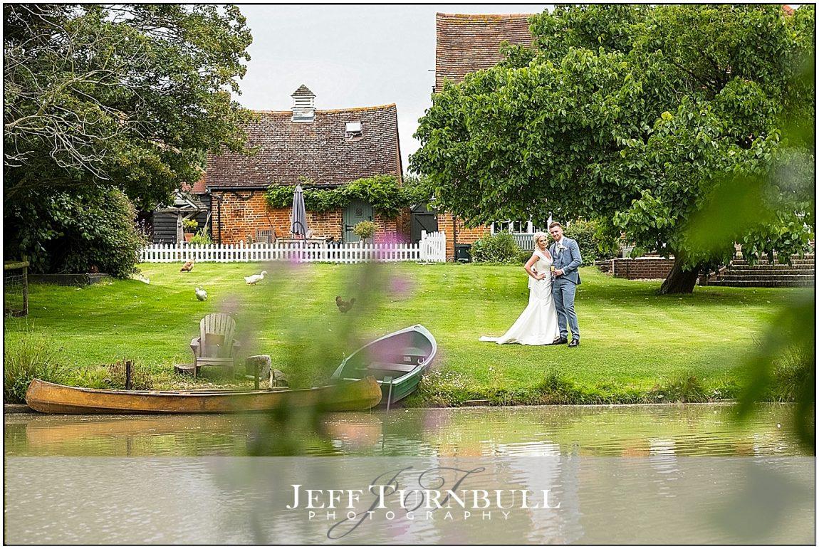 Bride Groom across the Lake Villiers Barn