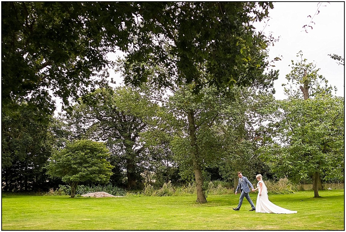 Wedding CoupleWalking in Villiers Barn Gardens