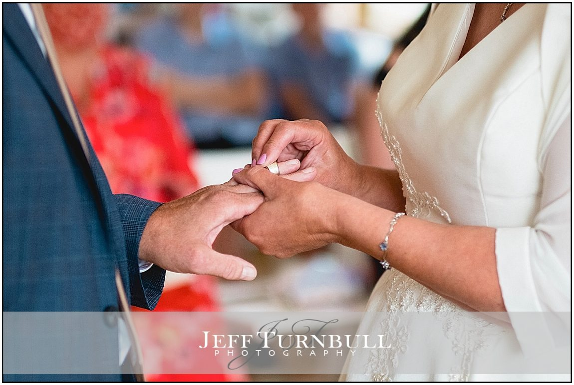 Bride puts on the Wedding Ring