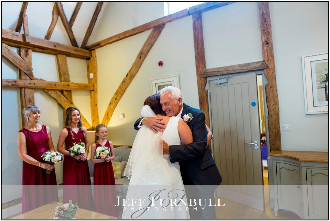 Bride and Dad having a hug