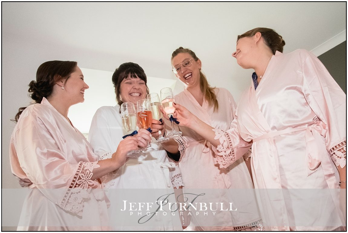 Bride and Bridesmaids Drinking Champgne
