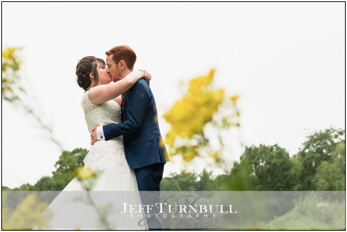 Wedding Couple Kissing at Stoke by Nayland